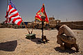 A U.S. Marine, with 3rd Battalion, 2nd Marine Regiment, Regimental Combat Team 8, pays his respects at the battlefield cross in honor of Cpl. Michael C. Nolen during a memorial ceremony at Patrol Base Talibjan 110703-M-PE262-008.jpg