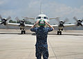 A U.S. Sailor assigned to Patrol Squadron (VP) 46 prepares to launch a P-3C Orion aircraft March 17, 2014, before its mission to assist in search and recovery operations for Malaysia Airlines Flight 370 140317-N-XY761-055.jpg