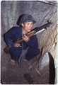 A Viet Cong soldier crouches in a bunker with an SKS rifle. - NARA - 530624.tif