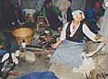 A group of women spinning wool using floor spinning wheels in Nepal.jpg