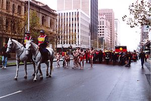 Australian Aboriginal Flag - Marching from Parliament House down King William Street to Victoria Square, Adelaide, to celebrate the 30th anniversary of the Aboriginal Flag, 8 July 2001.