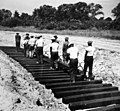African-American workers laying railroad ties for spur line, 1942 (27255092036).jpg