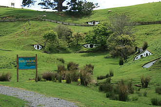 "Tolkien tourism - Many of the locations where parts of the movies were filmed have become destinations for curious travellers. However, since many of the most famous locations were on public lands (and the rules of use for the filming stipulated that the sites be returned to their natural state), only a few, like ""Hobbiton"" near Matamata retain any traces of the film sets."