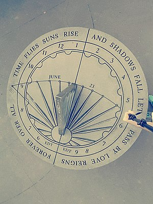"Air India Flight 182 - The rim of the sundial contains a poem reading ""Time flies suns rise and shadows fall let it pass by love reigns forever over all""."