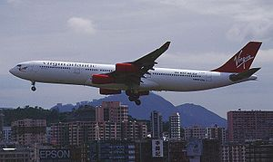"Virgin Atlantic - Airbus A340-300 landing at Kai Tak Airport, displaying the ""No Way BA/AA"" sticker"
