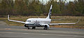 Alaska Air 737 holding at ANC (6194222310).jpg