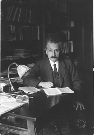Photograph of Albert Einstein in his office at...