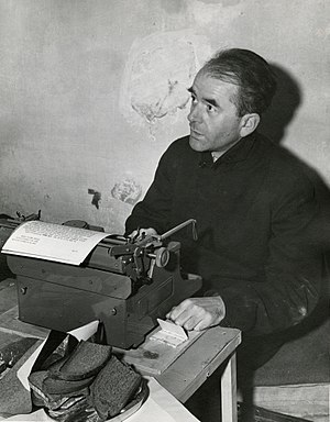 Spandau Prison - Albert Speer photographed in his cell at Nuremberg, during the Nuremberg trials. Speer was photographed working at a typewriter. November 24, 1945