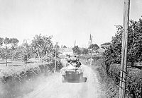 American armoured forces race through Ballon.jpg