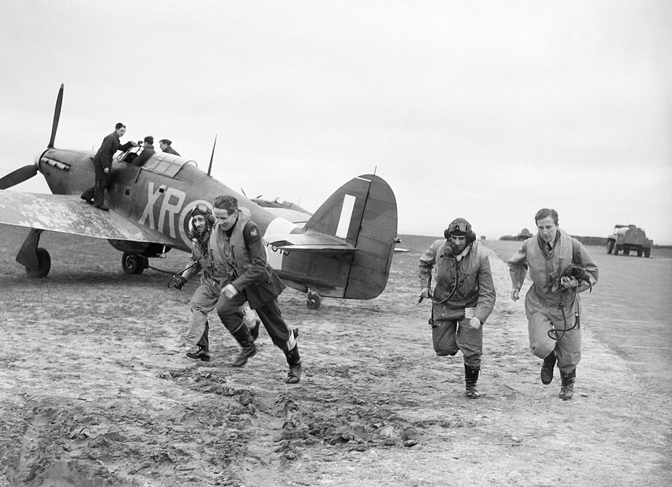 American pilots of No 71 'Eagle' Squadron rush to their Hawker Hurricanes at Kirton-in-Lindsey, 17 March 1941. CH2401