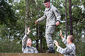 An Army Junior Officer Training Corps cadet crosses a balance-beam on the 7th Special Forces (Airborne) compound.jpg