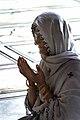 An elderly woman praying in a mosque in Delhi.jpg