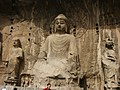Ancient Buddhist Grottoes at Longmen- Fengxian Temple, Vairocana Buddha.jpg