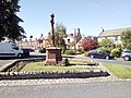 Ancrum war memorial and the pub.jpg