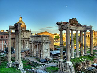 Saturn (mythology) - Ruins of the Temple of Saturn (eight columns to the far right) in February 2010, with three columns from the Temple of Vespasian and Titus (left) and the Arch of Septimius Severus (center)