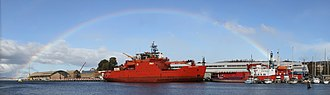 Aurora Australis (icebreaker) - Aurora Australis berthed in Hobart under a rainbow, with the French research vessel L'Astrolabe to the right.