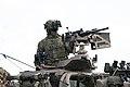 Australian soldier manning a heavy machine gun in a High Mobility Transporter during Talisman Sabre 2019.jpg