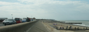 B1159 road - The seafront at Walcott with the B1159 to the left.
