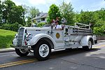 A white 1940s firetruck
