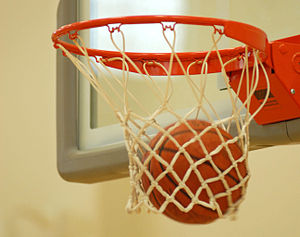 English: A basketball falls through the hoop
