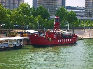 theatre boat moored in Paris, France, originally an Irish lighthouse boat