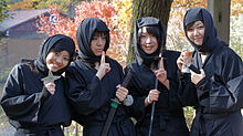 Four young women dressed in black