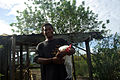 Bethesda student Kennedy holds one of the local chickens they are learning to keep. (10677059214).jpg