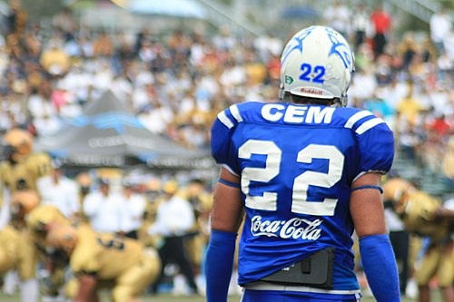 An American football player from the State of Mexico Campus overlooks the playing field. Teams from the Institute won every single American Football Collegiate Championship in Mexico from 1998 to 2008 Borregos Salvajes ITESM CEM.jpg