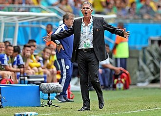 Safet Sušić - Sušić (back of the photo) with Bosnia and Herzegovina in match against Iran at the 2014 FIFA World Cup.