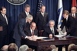 Bosnian President Alija Izetbegovic and Croatian President Franjo Tudjman sign the Croat-Muslim Federation Peace Agreement - Flickr - The Central Intelligence Agency.jpg