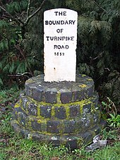 Turnpike marker 1852 showing southwest boundary of Ely