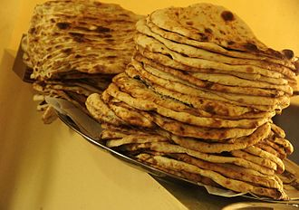 Afghan cuisine - Naan (bread) from a local baker, which is the most widely consumed bread in Afghanistan