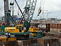 Building cranes and earthworks between Amsterdam Central Station and the waterfront of the IJ, 2006.jpg
