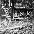 COLLECTIE TROPENMUSEUM Een D6 tractor met Heyster double drumm donkey en bulldozer (en een zonnedak bovenop) voor het omwerken van bomen TMnr 10010826.jpg