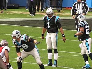 Jonathan Stewart - Stewart (far right) in 2011 against Tampa Bay