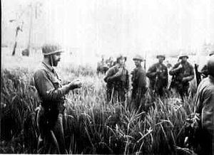 Carlson's patrol - A Marine officer briefs raider troops during the patrol
