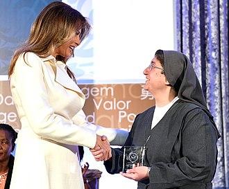 Carolin Tahhan Fachakh - Receiving her award from Melania Trump