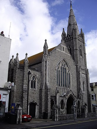 Central Methodist Church, Eastbourne - The Pevensey Road façade has a seven-light lancet window and pinnacled buttresses.