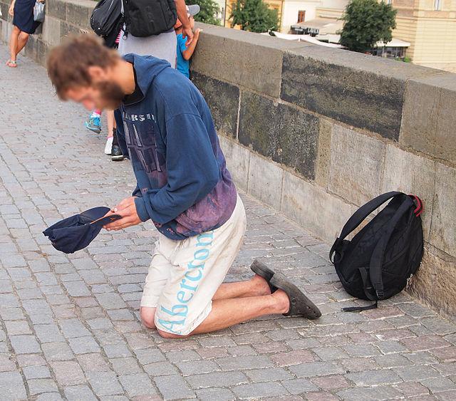 Charles Bridge - beggar