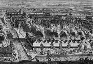 Bird's eye view of part of the city of Batavia where there is fighting while houses stand in flames in the foreground at the time of the massacre of the Chinese in 1740.