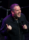 Colour photograph of Chris Moyles onstage in 2011.