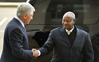 Yoweri Museveni - Museveni is greeted by US Secretary of Defense Chuck Hagel in 2013