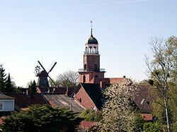 The church and windmill of Ditzum in Jemgum municipality