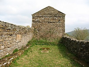 Low Row - The remains of Smarber Chapel in 2009, looking east.  The chapel is in the foreground.  The former cottage, now a barn, stands behind