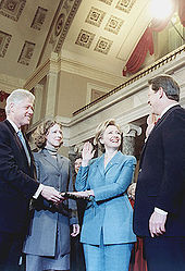 Clinton being sworn in as U.S. Senator by Vice President Al Gore in 2000, her husband Bill, and daughter Chelsea, are looking on.