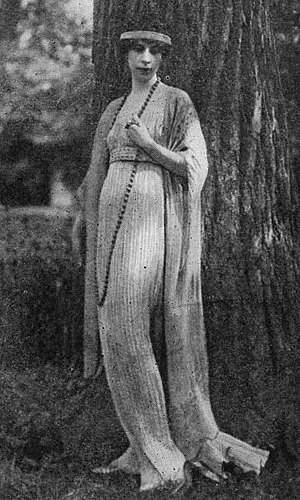 Mariano Fortuny (designer) -  Clarisse Coudert, who married Condé Nast, wearing a Fortuny tea gown. This one has no tunic but is finely pleated, in the Fortuny manner, and falls in long lines, closely following the figure, to the floor.
