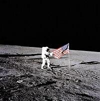 Conrad Unfurls Flag - GPN-2000-001104.jpg