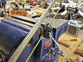 Cut the board with saw.JPG