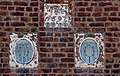 Datestone and oculi, Ashtree farmhouse.jpg
