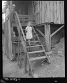 Daughter of Charlie Davis walking down the steps. Coleman Fuel Company, Red Bird Mine, Field, Bell County, Kentucky. - NARA - 541138.tif